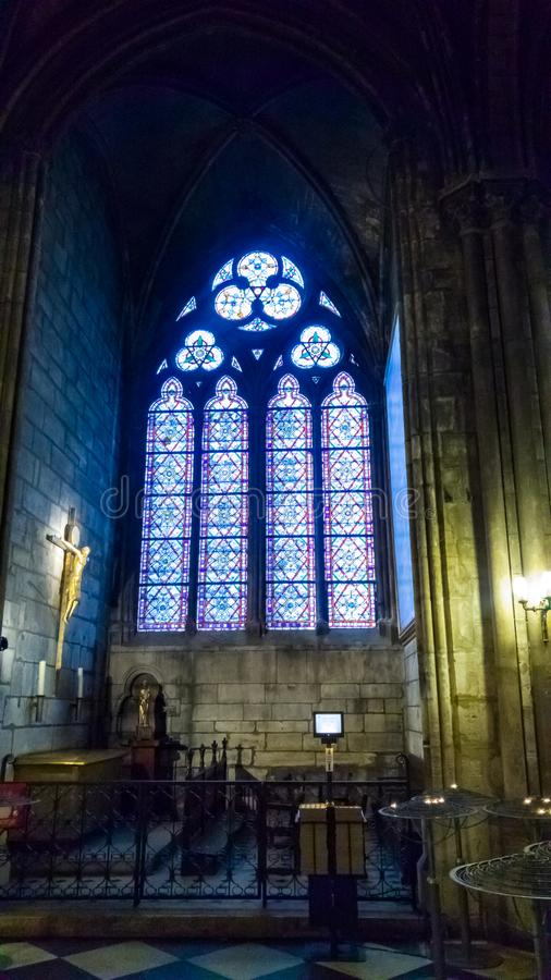 PARIS, FRANCE - OCTOBER 17, 2016: Notre Dame de Paris Cathedral, Interior view of columns and stained glass of the Cathedral royalty free stock image