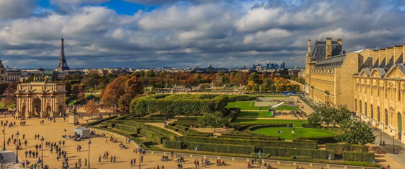 Panorama of Paris cityscape with the Tuileries Garden, the Arc du Carrousel and the Eiffel Tower in front of the Louvre Museum in. Paris, France - October 25 royalty free stock photos