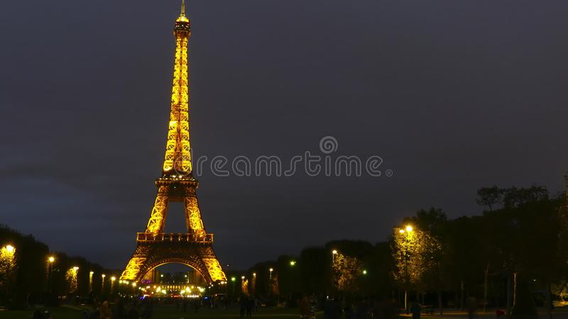 PARIS, FRANCE - OCTOBER 8, 2017. Time lapse of the illuminated Eiffel tower at night. PARIS, FRANCE - OCTOBER 8, 2017. Time lapse of the famous Eiffel tower in royalty free stock photo