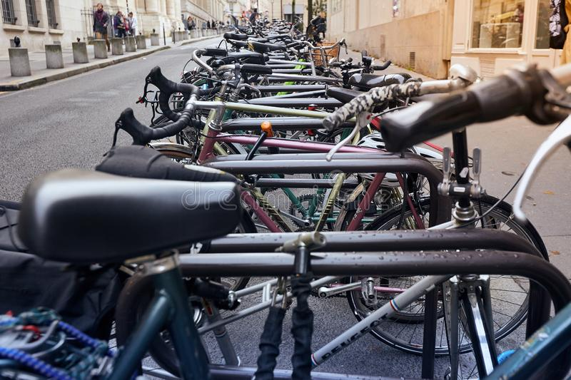 Paris, France - October 24, 2017: Urban scene. Bicycles parked near Sorbonne university stock photos