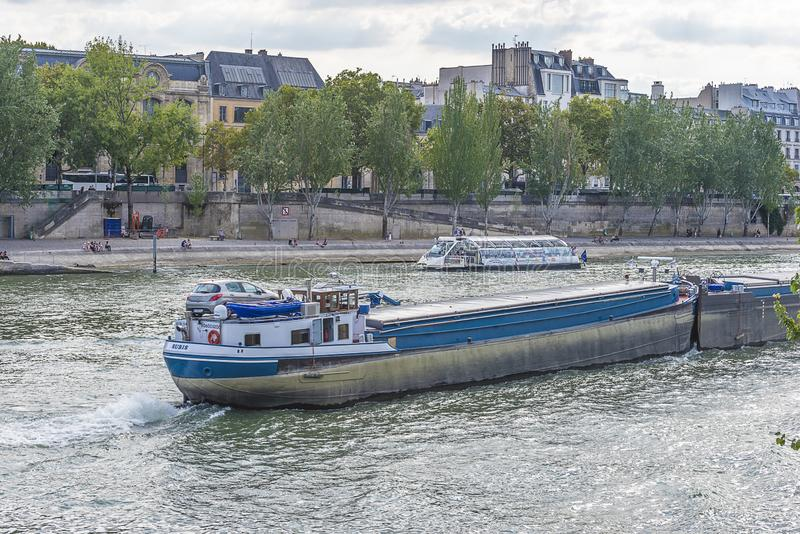 The Seine river with boats. Paris, France: the Seine river with boats royalty free stock photos