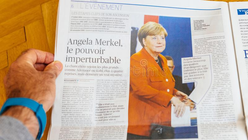 Le Figaro newspaper reporting about Angela Merkel election in Ge. PARIS, FRANCE - SEP 25, 2017: Le Figaro French International newspaper with portrait of Angela stock photos