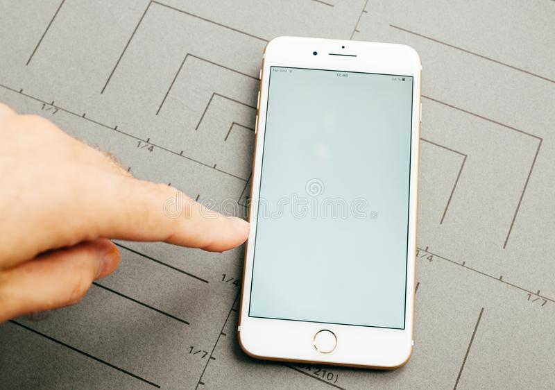 Blank screen on iPhone 7 Plus the application software. PARIS, FRANCE - SEP 26, 2016: Male hand holding New Apple iPhone 7 Plus after unboxing and testing broken royalty free stock images