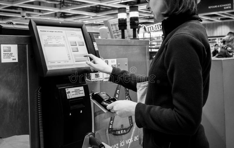 Woman using digital touchscreen to pay for products royalty free stock photos