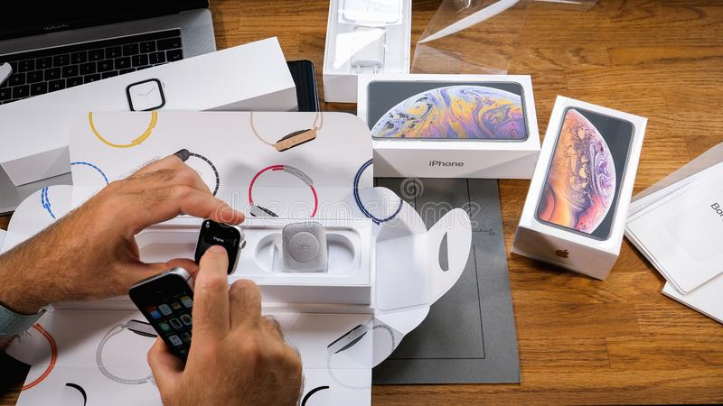 Man unboxing unpacking new Apple Watch Series 4 stock photos
