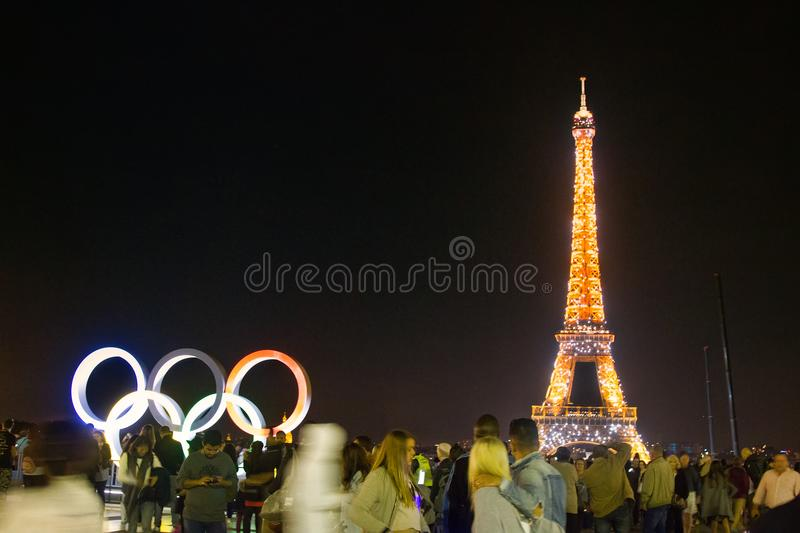 Eiffel Tower Tourists In Night Hours And Olympic Symbols Editorial