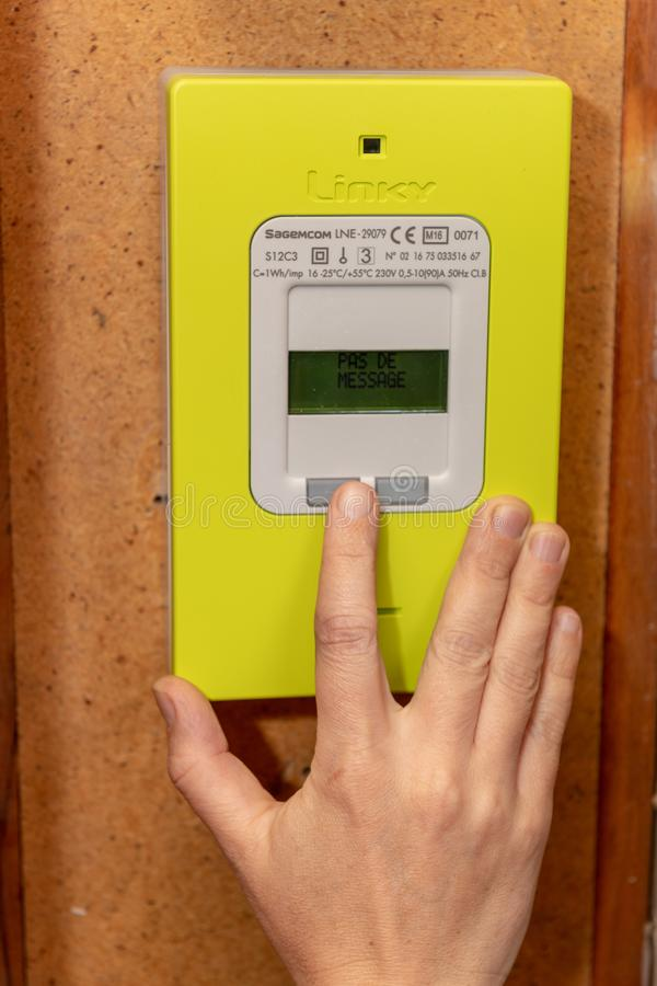 Paris, France - September 30, 2018 : Woman using new smart electric meter Linky from ERDF Electricity Network Distribution Franc stock photos