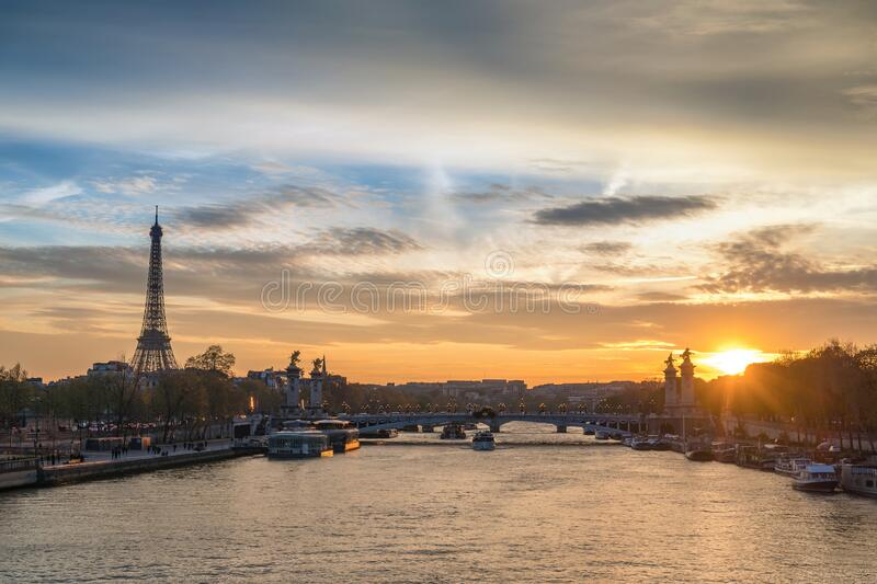 Paris France sunset at Seine River with Pont Alexandre III bridge and Eiffel Tower royalty free stock photography