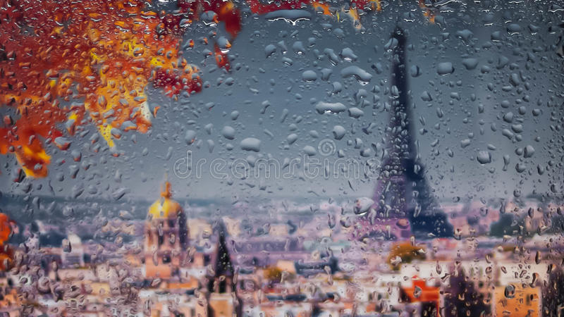 PARIS, FRANCE. A view of the city from a window from a high point during a rain. Rain drops on glass. Focus on drops stock images