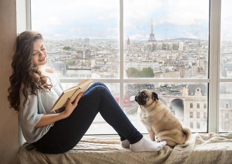 Beautiful long haired woman enjoying Paris France view outside the window stock photos