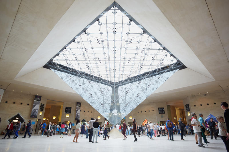 Paris, Inverted pyramid in the Louvre shopping mall. Paris, Inverted pyramid in the shopping mall 'Carrousel du Louvre' with people royalty free stock image
