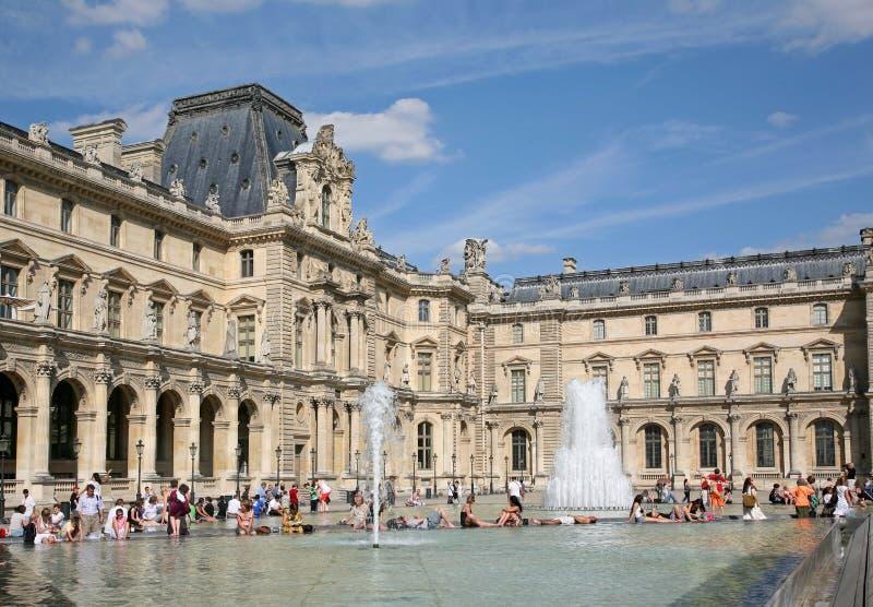 PARIS - The Louvre fountain stock photos