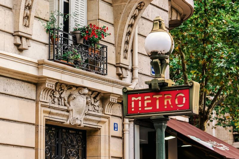 Paris Metro Retro Entrance Sign. Paris, France - August 11, 2017. Red metro entrance sign in Paris. Old traditional signpost for subway transportation in France royalty free stock image