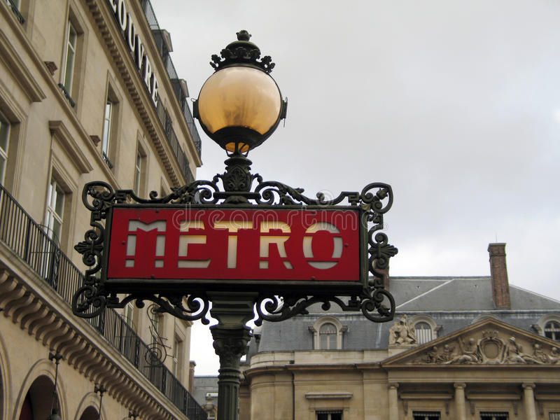 Paris Metro sign on a gray day royalty free stock photos