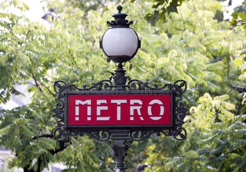 Paris metro sign with tree background stock image