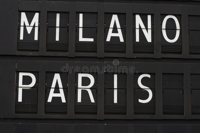 Paris and Milano - airport. Flights info board on airport concept. Fashion cities Paris and Milano royalty free stock photo