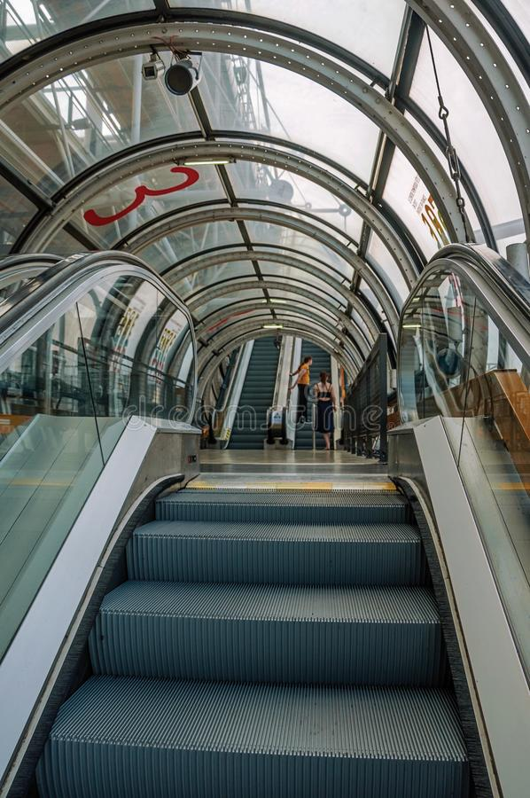 Details of escalator inside the Center Georges Pompidou and people in Paris. royalty free stock photo