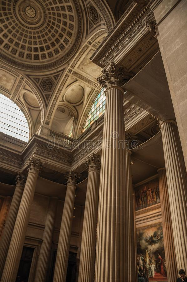 Pantheon inside view with high ceiling, columns, statues and paintings richly decorated in Paris. stock photos