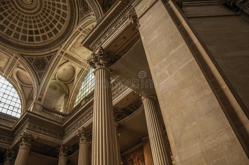 Pantheon inside view with high ceiling, columns, statues and paintings richly decorated in Paris. stock image