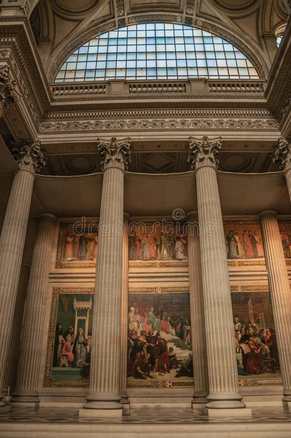 Pantheon inside view with high ceiling, columns, statues and paintings richly decorated in Paris. royalty free stock photo