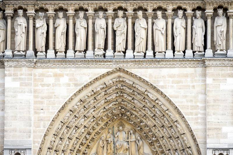 PARIS, NOTRE DAME: The gallery of the Kings is placed above the portals and consists of a loggia formed by twenty-three trilobate. Arches resting on small royalty free stock images
