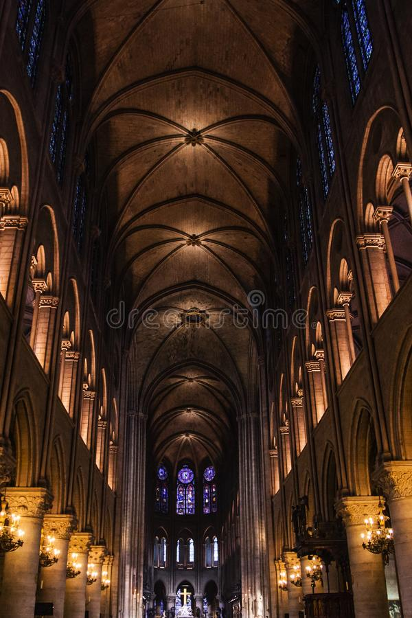 PARIS - OCTOBER1, 2016: Notre Dame de Paris Cathedral Interior on October 1, 2016. Notre Dame construction began in the year 1163. And was completed in the year royalty free stock photo