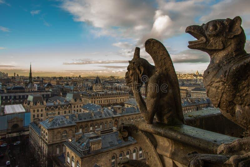 Paris panorama gargouiile stone statues. Watching the view royalty free stock image