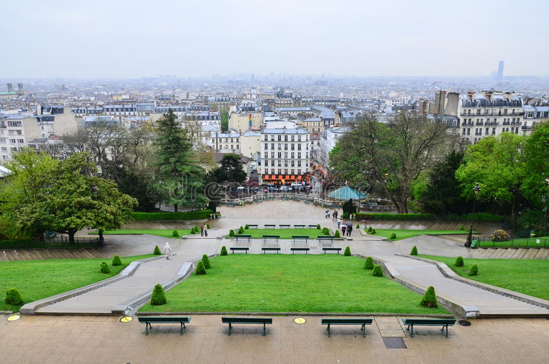 Paris rain green. Long famous Montmartre stairs with traditional old city lamps and couple on the top, Paris, France royalty free stock images