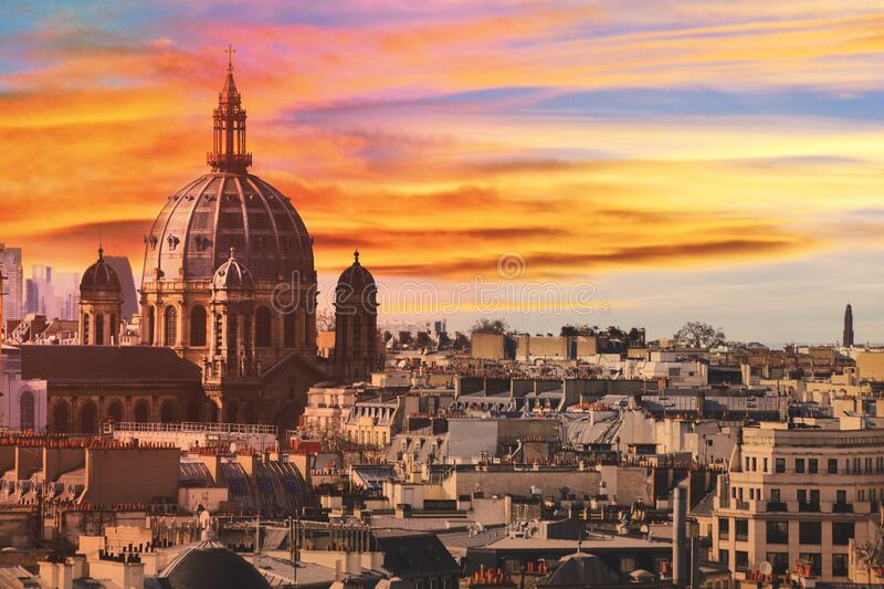 Paris roofs warm sunset stock photo