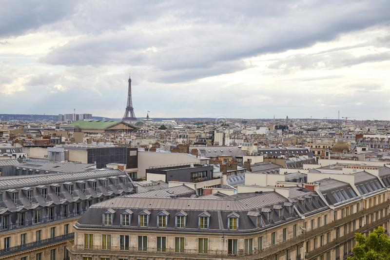 Paris rooftops view and Eiffel Tower in a cloudy day in France stock photo