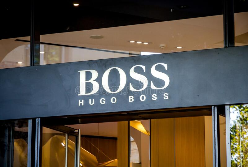 Paris - September 10, 2019 : The Hugo Boss luxury store entrance sign on Champs-Elysees avenue stock photo