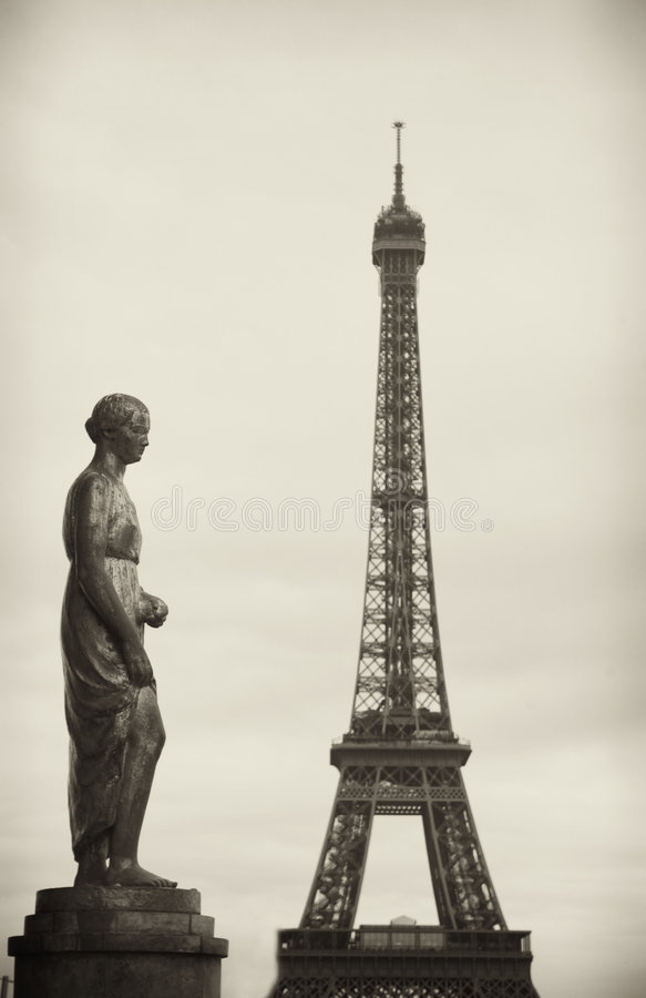 Paris with a statue and Eiffel Tower stock photo