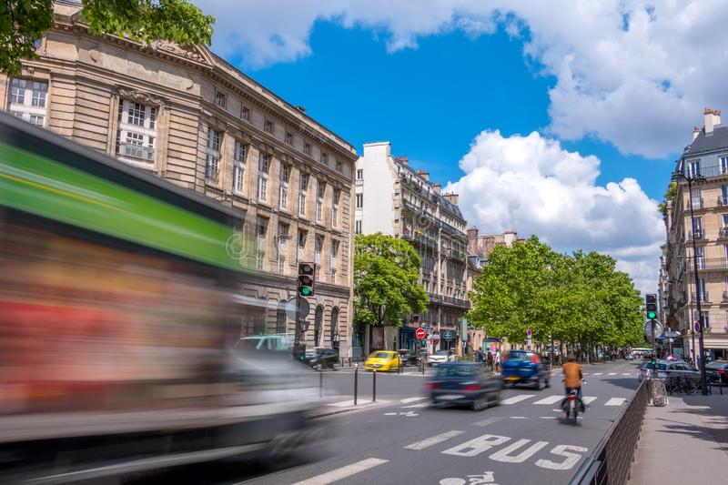 Paris Traffic on a Sunny Summer Day. France. Paris. Street in the city center with busy traffic. Sunny summer day stock image