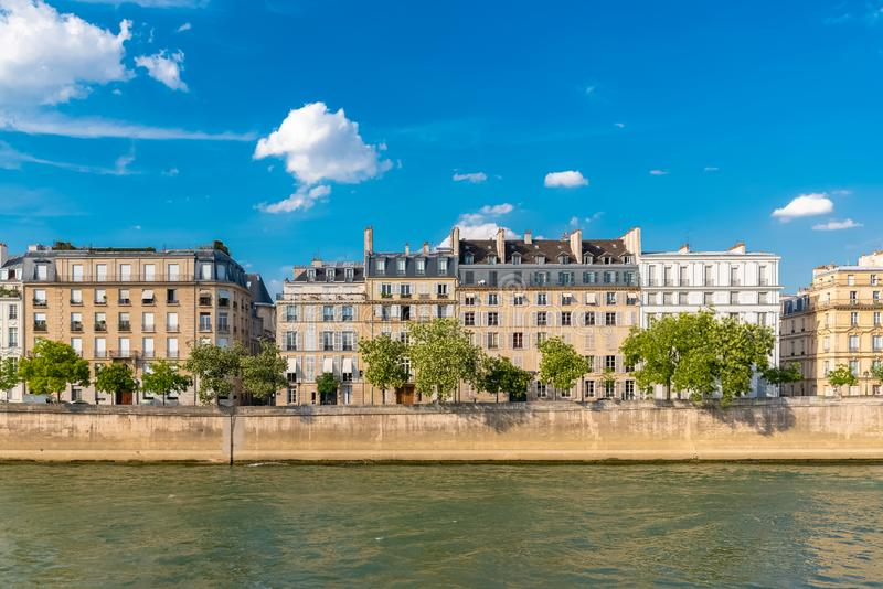 Paris, view of ile saint-louis. And quai d`Orleans, beautiful buildings and quays in summer royalty free stock photo