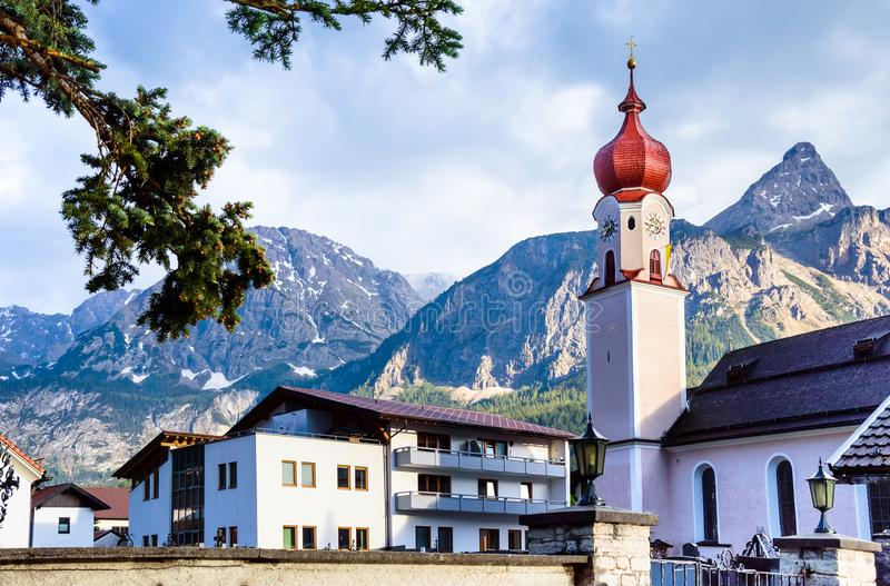Parish church of Maria Heimsuchung with Sonnenspitze - Ehrwald, Austrian Alps. Parish church of Maria Heimsuchung with mountains in the background - Ehrwald royalty free stock photos