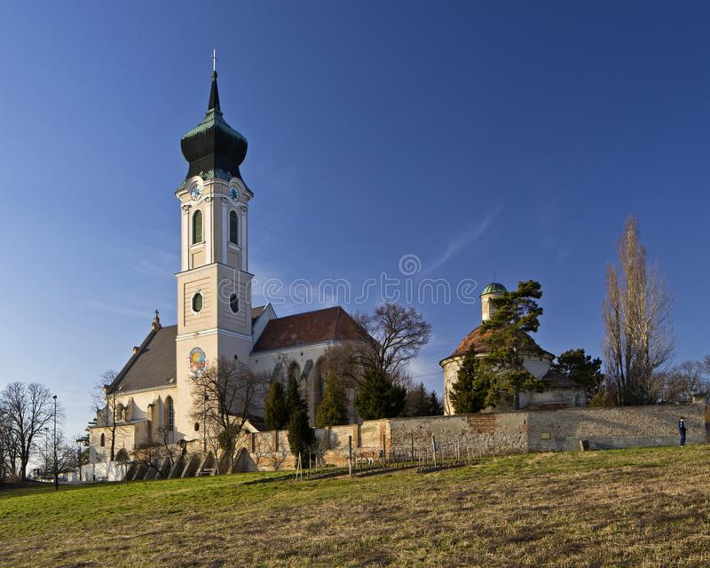 The parish church in Mistelbach, Lower Austria. Ensemble with graveyard and ossuary. Architecture of baroque, gothic an romanesque stock photography