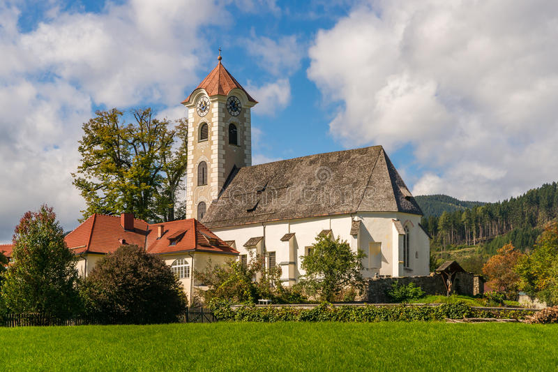 Parish church in Obermühlbach. View of the gothic-baroque style parish church in Obermuehlbach in Carinthia, Austria stock photography