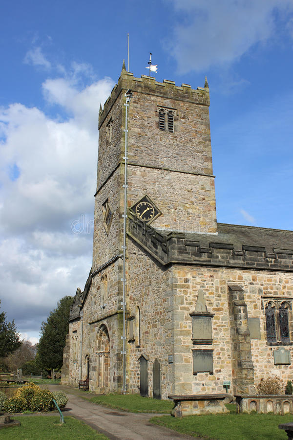 Parish Church of St Mary's Kirkby Lonsdale Cumbria. Clock, tower and part of the Parish Church of St. Mary at Kirkby Lonsdale in Cumbria, England, United Kingdom stock photo