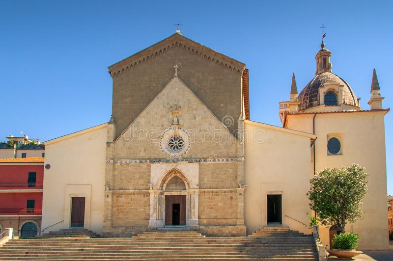 Parish S. Maria Assunta church building in Orbetello town in Italy. Cathedral Of Saint Mary Assunta historic landmark and place of worship stock photos