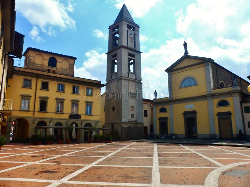 The parish of San Piero of Agliana. The parish of San Piero with its bell tower in the historic center of Agliana in Tuscany, Italy stock images