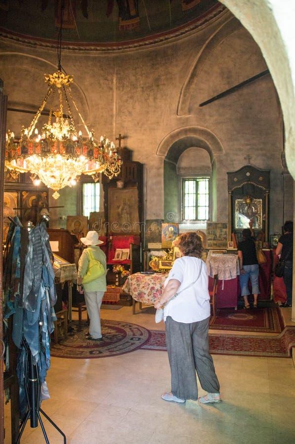 Parishioners at the church Dryanovo Monastery, Bulgaria royalty free stock photo