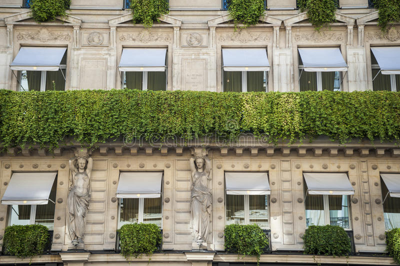 Parisian apartment building with flower boxes stock photo