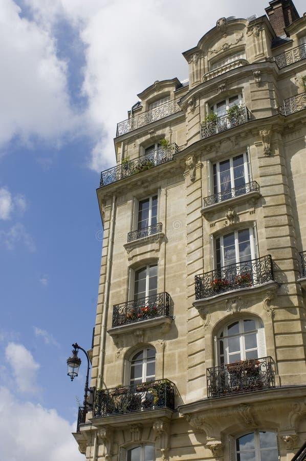 Parisian Balconies. Architectural details of an Art Nouveau facade of a building on Ile de La Cit�, with it's balconies, archetypal street light, chimneys royalty free stock image