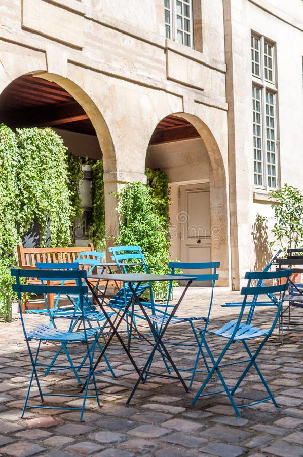 Parisian cafe terrace in the cobbled streets of old Paris royalty free stock photo