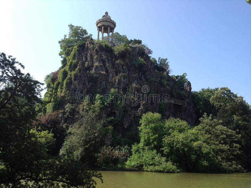 Parisian tale. Temple in the suburbs of Paris, Parc des Buttes Chaumont, France. The photo was taken in the summer of 2013 stock photo