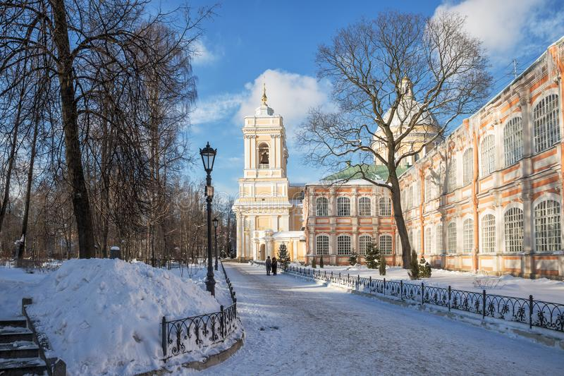 Park in Alexander Nevsky Lavra. Holy Trinity Cathedral and Feodorovsky building in the Alexander Nevsky Lavra, St. Petersburg, Russia royalty free stock photos
