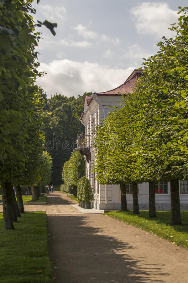 Park Alley and Marley pavilion Palace in Peterhof ,St. Petersburg, Russia. stock photography