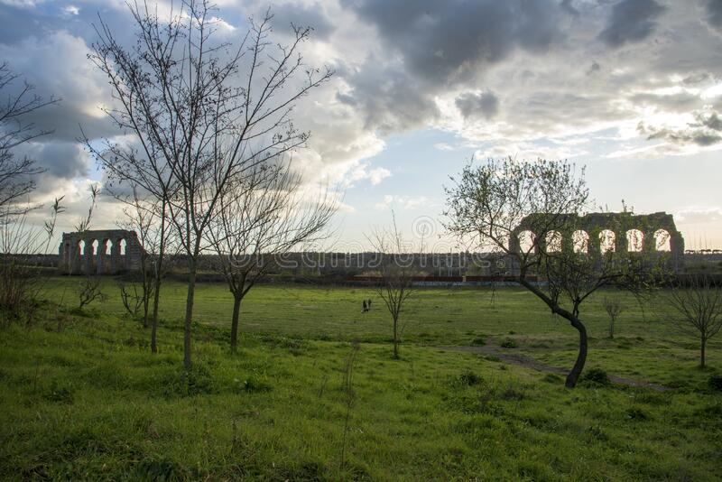 Park of the aqueducts at sunset royalty free stock photo
