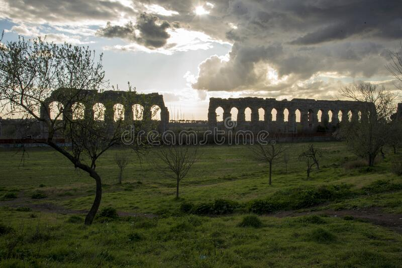 Park of the aqueducts at sunset royalty free stock image
