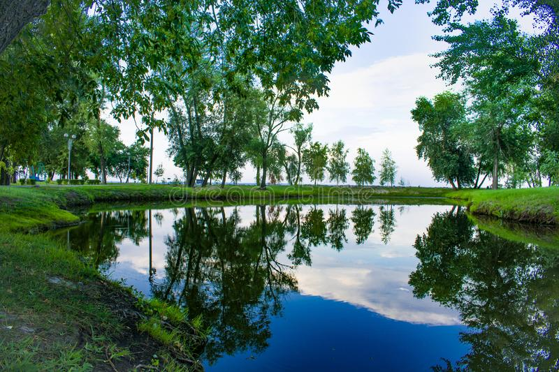 Park area with a beautiful lake stock photo